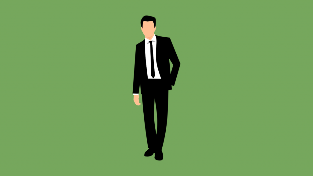 Businessman in suit on green background.