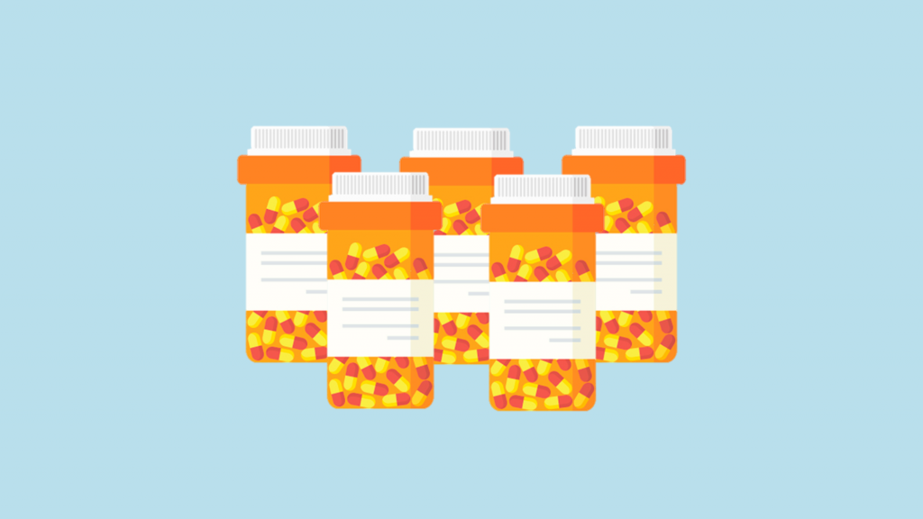 Two rows of prescription pill bottles